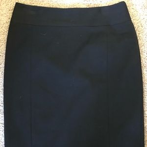 Black pencil skirt with black button detail